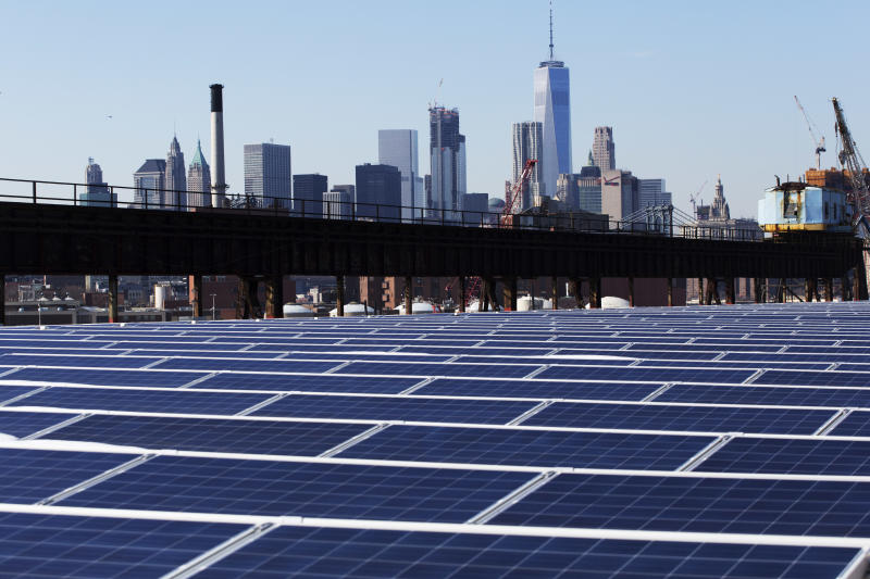 In this Feb. 14, 2017 photo, a rooftop is covered with solar panels at the Brooklyn Navy Yard in New York. The Manhattan skyline is at top. Even if President Donald Trump withdraws U.S. support for the Paris climate change accord, domestic efforts to battle global warming will continue. Dozens of states and many cities have policies intended to reduce emissions of greenhouses gases and deal with the effects of rising temperatures. Even in red states, many consider flood prevention and renewable energy are considered smart business. (AP Photo/Mark Lennihan)