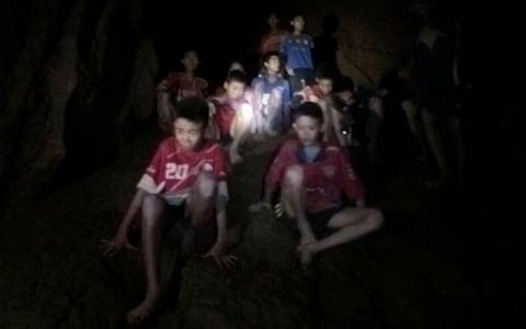 The boys and football coach when they found in the cave - Credit: Tham Luang Rescue Operation Center/AP