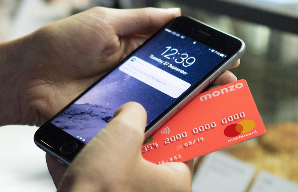 Monzo's recognisable coral card. Photo: Monzo