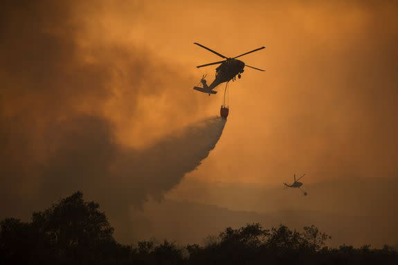 "<img alt=""""/><p>As wildfires continue to blaze throughout Southern California, displacing residents and destroying buildings, terrifying images and videos show firefighters struggling to battle the historically large Thomas Fire.</p> <div><p>SEE ALSO: <a rel=""nofollow"" href=""http://mashable.com/2017/12/07/southern-california-fires-how-to-help/"">How to help victims of the Southern California wildfires</a></p></div> <p>As of Monday morning, the fire had grown to 230,500 acres, and spread from Ventura County into Santa Barbara County. Ventura County's crisis center <a rel=""nofollow"" href=""http://www.readyventuracounty.org/"">reports</a> that the fire is 15 percent contained. </p> <p>The fire's flames are being fed by strong Santa Ana winds and plenty of fuel in the form of dried out plant life that grew after a wet winter and subsequently dried out after a dry summer in the state.</p> <p><img title=""The fire has grown to over 230,000 acres, and threatens areas in Ventura and Santa Barbara counties."" alt=""The fire has grown to over 230,000 acres, and threatens areas in Ventura and Santa Barbara counties.""></p> <p>The fire has grown to over 230,000 acres, and threatens areas in Ventura and Santa Barbara counties.</p><div><p>Image:  <a rel=""nofollow"" href=""http://vcfd.org/"">Ventura county fire department</a></p></div><div><div><blockquote> <p>The <a rel=""nofollow"" href=""https://twitter.com/hashtag/ThomasFire?src=hash&ref_src=twsrc%5Etfw"">#ThomasFire</a> so far:<br>–230,500 acres<br>–15% contained<br>–796 structures destroyed<br>–18,000 buildings threatened<br>–New evacuation orders issued Sunday night<a rel=""nofollow"" href=""https://t.co/HoFWZT15W1"">https://t.co/HoFWZT15W1</a> <a rel=""nofollow"" href=""https://t.co/OXztvKrPBe"">pic.twitter.com/OXztvKrPBe</a></p> <p>— Los Angeles Times (@latimes) <a rel=""nofollow"" href=""https://twitter.com/latimes/status/940248599400734722?ref_src=twsrc%5Etfw"">December 11, 2017</a></p> </blockquote></div></div> <p>Firefighters have made progress quenching the flames on the fire's southern side, and City of Ventura residents have been allowed to return to their homes. </p> <p>However, the fire's latest drive north into Santa Barbara has triggered additional evacuations in Carpinteria and Montecito. </p> <p><img title=""Flames come close to a house as the Thomas Fire advances toward Santa Barbara County seaside communities."" alt=""Flames come close to a house as the Thomas Fire advances toward Santa Barbara County seaside communities.""></p> <p>Flames come close to a house as the Thomas Fire advances toward Santa Barbara County seaside communities.</p><div><p>Image:   David McNew/Getty Images</p></div><div><div><blockquote> <p><a rel=""nofollow"" href=""https://twitter.com/hashtag/ThomasFire?src=hash&ref_src=twsrc%5Etfw"">#ThomasFire</a> - FF's knock down flames as they advance on homes atop Shepherd Mesa Road in Carpinteria at 6 am Sunday morning. <a rel=""nofollow"" href=""https://t.co/86OjtRh9hQ"">pic.twitter.com/86OjtRh9hQ</a></p> <p>— SBCFireInfo (@EliasonMike) <a rel=""nofollow"" href=""https://twitter.com/EliasonMike/status/939862355344683008?ref_src=twsrc%5Etfw"">December 10, 2017</a></p> </blockquote></div></div> <div><div><blockquote> <p>Massive imposing smoke from <a rel=""nofollow"" href=""https://twitter.com/hashtag/ThomasFire?src=hash&ref_src=twsrc%5Etfw"">#ThomasFire</a> today. Looking west from Newbury Park. <a rel=""nofollow"" href=""https://t.co/gekRcWcPiO"">pic.twitter.com/gekRcWcPiO</a></p> <p>— Greg Vit (@gvitty) <a rel=""nofollow"" href=""https://twitter.com/gvitty/status/939981486685437952?ref_src=twsrc%5Etfw"">December 10, 2017</a></p> </blockquote></div></div> <p><img title=""A firefighter battling the Thomas Fire near Lake Casitas."" alt=""A firefighter battling the Thomas Fire near Lake Casitas.""></p> <p>A firefighter battling the Thomas Fire near Lake Casitas.</p><div><p>Image:  David McNew/Getty Images</p></div><div><div></div></div> <p><img title=""Firefighters use drip torches to set a backfire at night in an effort to make progress against the Thomas Fire."" alt=""Firefighters use drip torches to set a backfire at night in an effort to make progress against the Thomas Fire.""></p> <p>Firefighters use drip torches to set a backfire at night in an effort to make progress against the Thomas Fire.</p><div><p>Image:  David McNew/Getty Images</p></div><p>According to the <a rel=""nofollow"" href=""http://www.latimes.com/local/lanow/la-me-thomas-fire-santa-barbara-fire-20171210-story.html""><em>Los Angeles Times</em></a>, 88,000 people have had to evacuate their homes, and the cost of fighting the fire is estimated at $25 million.</p> <p>The Thomas Fire continues to rage as firefighters also work to contain the Creek, Rye, Skirball, and Lilac fires in Los Angeles and San Diego counties.</p> <p><img title=""Firefighters watch after setting a backfire at night to make progress against the Thomas Fire,"" alt=""Firefighters watch after setting a backfire at night to make progress against the Thomas Fire,""></p> <p>Firefighters watch after setting a backfire at night to make progress against the Thomas Fire,</p><div><p>Image:  David McNew/Getty Images</p></div><p><img title=""The Thomas fire burns through Los Padres National Forest."" alt=""The Thomas fire burns through Los Padres National Forest.""></p> <p>The Thomas fire burns through Los Padres National Forest.</p><div><p>Image:  Noah Berger/AP/REX/Shutterstock</p></div><p><img title=""Horses that were evacuated from the Thomas Fire are seen on December 10, 2017 in Ojai, California."" alt=""Horses that were evacuated from the Thomas Fire are seen on December 10, 2017 in Ojai, California.""></p> <p>Horses that were evacuated from the Thomas Fire are seen on December 10, 2017 in Ojai, California.</p><div><p>Image:   David McNew/Getty Images</p></div><p><img title=""Firefighters monitor a section of the Thomas Fire along the 101 freeway."" alt=""Firefighters monitor a section of the Thomas Fire along the 101 freeway.""></p> <p>Firefighters monitor a section of the Thomas Fire along the 101 freeway.</p><div><p>Image:  Mario Tama/Getty Images</p></div><p>California Governor <a rel=""nofollow"" href=""http://www.latimes.com/local/lanow/la-me-socal-fires-20171210-story.html"">Jerry Brown called the fires</a> a ""terrible tragedy,"" and also warned that, thanks to climate change, massive wildfire seasons could become the norm.</p> <p>""This could be something that happens every year or every few years,"" Brown said. ""We're about to have a firefighting Christmas.""</p> <p><img title=""DEC 10: Christmas decorations illuminate a house as the growing Thomas Fire advances toward Santa Barbara County."" alt=""DEC 10: Christmas decorations illuminate a house as the growing Thomas Fire advances toward Santa Barbara County.""></p> <p>DEC 10: Christmas decorations illuminate a house as the growing Thomas Fire advances toward Santa Barbara County.</p><div><p>Image:  David McNew/Getty Images</p></div><p><img title=""DEC 10:: People watch as the Thomas Fire advances toward Santa Barbara County."" alt=""DEC 10:: People watch as the Thomas Fire advances toward Santa Barbara County.""></p> <p>DEC 10:: People watch as the Thomas Fire advances toward Santa Barbara County.</p><div><p>Image:   David McNew/Getty Images</p></div><p>Celebrities like Ellen Degeneres and Oprah Winfrey, who live in the area, have tweeted their support for those in the path of the fires.</p> <div><div><blockquote> <p>Everyone in the Montecito area is checking up on each other and helping to get people and animals to safety. I'm proud to be a part of this community. I'm sending lots of love and gratitude to the fire department and sheriffs. Thank you all. <a rel=""nofollow"" href=""https://twitter.com/hashtag/ThomasFire?src=hash&ref_src=twsrc%5Etfw"">#ThomasFire</a></p> <p>— Ellen DeGeneres (@TheEllenShow) <a rel=""nofollow"" href=""https://twitter.com/TheEllenShow/status/940007382528139264?ref_src=twsrc%5Etfw"">December 10, 2017</a></p> </blockquote></div></div> <div><div><blockquote> <p>Peace be Still, is my prayer tonight. For  all the fires raging thru my community and beyond. <a rel=""nofollow"" href=""https://twitter.com/hashtag/peacebestill?src=hash&ref_src=twsrc%5Etfw"">#peacebestill</a>🙏🏾</p> <p>— Oprah Winfrey (@Oprah) <a rel=""nofollow"" href=""https://twitter.com/Oprah/status/940058257141391362?ref_src=twsrc%5Etfw"">December 11, 2017</a></p> </blockquote></div></div> <p>Schools remain closed, and the University of California, Santa Barbara has postponed exams until after the new year.</p> <div><div><blockquote> <p>Final exams scheduled for the coming week will be rescheduled for the week of January 8. <a rel=""nofollow"" href=""https://twitter.com/hashtag/UCSB?src=hash&ref_src=twsrc%5Etfw"">#UCSB</a> students who wish to leave campus are encouraged to do so. Please read additional details in this Sunday memo from Chancellor Yang: <a rel=""nofollow"" href=""https://t.co/fIwSFD0iFm"">https://t.co/fIwSFD0iFm</a></p> <p>— UC Santa Barbara (@ucsantabarbara) <a rel=""nofollow"" href=""https://twitter.com/ucsantabarbara/status/939982695890812928?ref_src=twsrc%5Etfw"">December 10, 2017</a></p> </blockquote></div></div> <div><div><blockquote> <p>Fires this morning above Carpenteria High School. Evacuations in this area. <a rel=""nofollow"" href=""https://twitter.com/hashtag/kcrw?src=hash&ref_src=twsrc%5Etfw"">#kcrw</a> <a rel=""nofollow"" href=""https://twitter.com/hashtag/kcrwsantabarbara?src=hash&ref_src=twsrc%5Etfw"">#kcrwsantabarbara</a> <a rel=""nofollow"" href=""https://twitter.com/hashtag/ThomasFire?src=hash&ref_src=twsrc%5Etfw"">#ThomasFire</a> <a rel=""nofollow"" href=""https://t.co/BM0f2acGXH"">pic.twitter.com/BM0f2acGXH</a></p> <p>— Saul Gonzalez (@SaulKCRW) <a rel=""nofollow"" href=""https://twitter.com/SaulKCRW/status/940226836767719424?ref_src=twsrc%5Etfw"">December 11, 2017</a></p> </blockquote></div></div> <p>8,500 firefighters are battling six wildfires across Southern California. Along with the massive wildfires that <a rel=""nofollow"" href=""http://mashable.com/2017/10/09/horrific-photos-show-apocalyptic-scenes-california-wildfires/"">ravaged Northern California</a> wine country this fall, 2017 has made for one of the <a rel=""nofollow"" href=""http://mashable.com/2017/12/05/california-wildfires-thomas-fire-ventura-santa-ana-winds/"">worst fire seasons</a> in California's history.</p> <div><div><blockquote> <p>Going above and beyond clearing a path for fire personal to get in and out with a Caltrans plow on hwy 33 north of Ojai. <a rel=""nofollow"" href=""https://twitter.com/hashtag/Hwy33?src=hash&ref_src=twsrc%5Etfw"">#Hwy33</a> <a rel=""nofollow"" href=""https://twitter.com/hashtag/ThomasFire?src=hash&ref_src=twsrc%5Etfw"">#ThomasFire</a> <a rel=""nofollow"" href=""https://twitter.com/hashtag/ForestService?src=hash&ref_src=twsrc%5Etfw"">#ForestService</a> <a rel=""nofollow"" href=""https://twitter.com/hashtag/Caltrans?src=hash&ref_src=twsrc%5Etfw"">#Caltrans</a> <a rel=""nofollow"" href=""https://twitter.com/LosPadresNF?ref_src=twsrc%5Etfw"">@LosPadresNF</a> <a rel=""nofollow"" href=""https://twitter.com/usfs_r5?ref_src=twsrc%5Etfw"">@usfs_r5</a> <a rel=""nofollow"" href=""https://twitter.com/R5_Fire_News?ref_src=twsrc%5Etfw"">@R5_Fire_News</a> <a rel=""nofollow"" href=""https://t.co/WQt6gLPQct"">pic.twitter.com/WQt6gLPQct</a></p> <p>— RW805 (@RW805) <a rel=""nofollow"" href=""https://twitter.com/RW805/status/940074386777825281?ref_src=twsrc%5Etfw"">December 11, 2017</a></p> </blockquote></div></div> <div><div><blockquote> <p>The massive <a rel=""nofollow"" href=""https://twitter.com/hashtag/ThomasFire?src=hash&ref_src=twsrc%5Etfw"">#ThomasFire</a> from Oxnard. <a rel=""nofollow"" href=""https://t.co/Yn6jG5kZw3"">pic.twitter.com/Yn6jG5kZw3</a></p> <p>— Joe Buttitta (@KEYTNC3Joe) <a rel=""nofollow"" href=""https://twitter.com/KEYTNC3Joe/status/939887621651677184?ref_src=twsrc%5Etfw"">December 10, 2017</a></p> </blockquote></div></div> <p><img title=""National Guard helicopters make water drop as the Thomas Fire approaches the Lake Casitas."" alt=""National Guard helicopters make water drop as the Thomas Fire approaches the Lake Casitas.""></p> <p>National Guard helicopters make water drop as the Thomas Fire approaches the Lake Casitas.</p><div><p>Image:  David McNew/Getty Images</p></div><div><p></p></div>  <div><div><blockquote> <p><a rel=""nofollow"" href=""https://twitter.com/hashtag/ThomasFire?src=hash&ref_src=twsrc%5Etfw"">#ThomasFire</a>- View from Shepard Mesa Drive at 3:48 am looking north.  SBSO has evacuated area & FD has engines on structure protection. <a rel=""nofollow"" href=""https://t.co/trdzfOMFCJ"">pic.twitter.com/trdzfOMFCJ</a></p> <p>— SBCFireInfo (@EliasonMike) <a rel=""nofollow"" href=""https://twitter.com/EliasonMike/status/939824324885733376?ref_src=twsrc%5Etfw"">December 10, 2017</a></p> </blockquote></div></div> <div> <h2><a rel=""nofollow"" href=""http://mashable.com/2017/12/08/extreme-weather-texas-fires-in-california/"">WATCH: Different parts of the US are experiencing totally opposite weather extremes</a></h2> <div> <p><img alt=""Https%3a%2f%2fvdist.aws.mashable.com%2fcms%2f2017%2f12%2fd77ce9fd 7bda 2030%2fthumb%2f00001""></p>   </div> </div>"