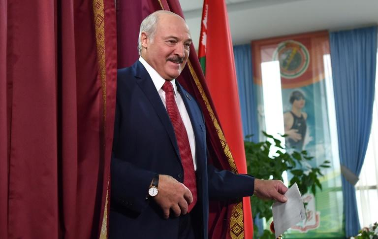 Lukashenko confirmed he would again be a candidate in next year's presidential election, as he cast his ballot (AFP Photo/Sergei GAPON                )