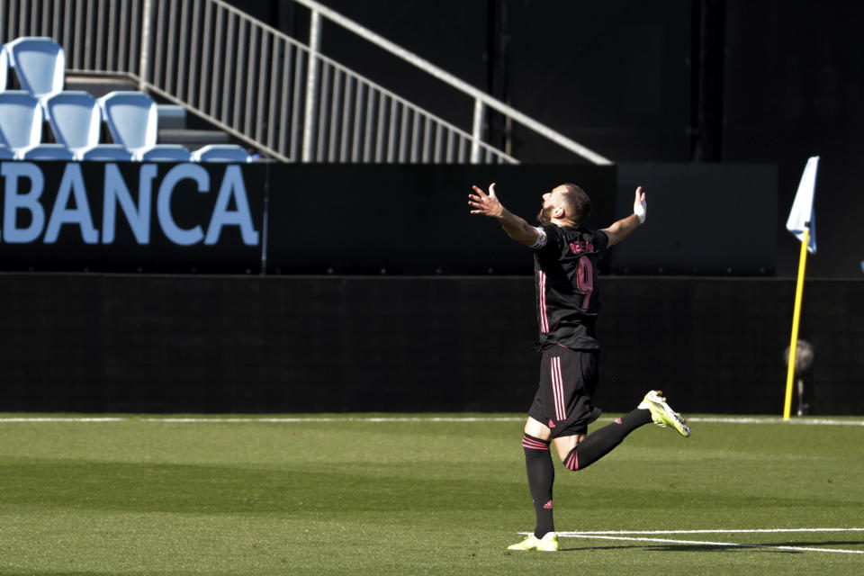 Real Madrid's Karim Benzema celebrates after scoring his side's second goal during a Spanish La Liga soccer match between Celta and Real Madrid at the Balaidos stadium in Vigo, Spain, Saturday March 20, 2021. (AP Photo/Lalo R.Villar)