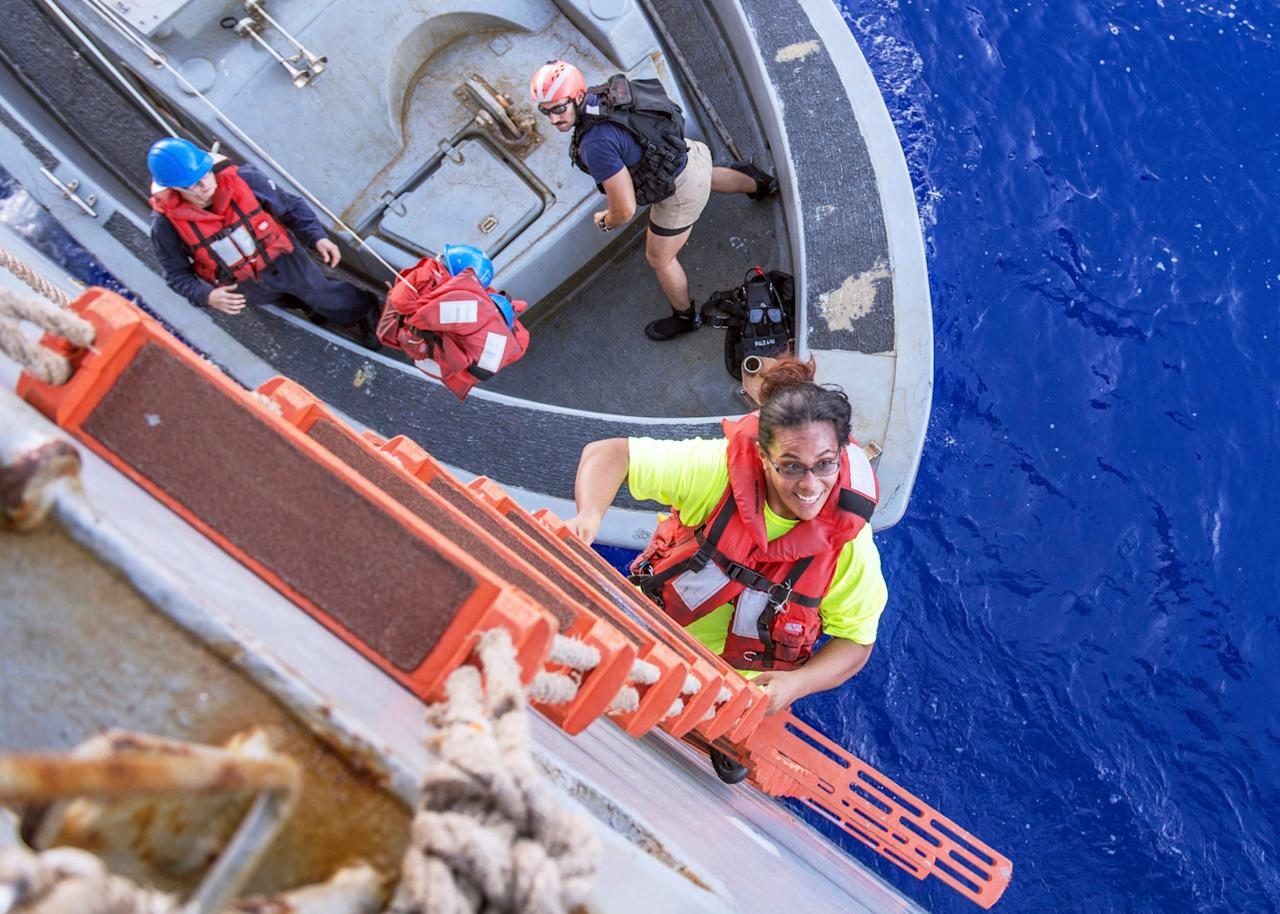 """Two women have described their despair during five months lost on the Pacific Ocean, trying to avoid the attention of sharks and stave off thoughts of death after their stricken yacht drifted thousands of miles off course. Jennifer Appel and Tasha Fuiava, from Hawaii, said their two dogs kept up morale during the darkest moments. Their ordeal came to an end on Wednesday when they were rescued by the US Navy. They were picked up about 900 miles southeast of Japan, about 5000 miles from their intended destination of Tahiti. """"When I saw the grey boat on the edge of the horizon, my heart leapt because I knew we were about to be saved,"""" Ms Appel told NBC News. """"Because I honestly believed we were going to die within the next 24 hours."""" Things quickly went wrong after they set off from Honolulu in May. One of their mobile phones was washed overboard on the first day. Credit: U.S. Navy via AP Part of the mast failed, limiting their speed to just four or five knots, and a storm flooded the engine making it inoperable after a month. They pressed on under sail power but their 50ft vessel, the Sea Nymph, drifted well off course. The two women realised the dire state of their predicament after two months – the intended length of their journey – but there was no-one close enough to pick up their distress signals, which they sent non-stop for 98 days. Pacific Rescue - women sailors and their dogs They had water purifiers and enough food to last a year but other dangers lurked in the deep. One night they counted seven sharks in the water around them, some as long as 30 feet. They slapped against the hull as the two mariners hid below deck, desperately trying to keep their dogs, Valentine and Zeus, quiet so the predators would lose interest. """"We basically laid huddled on the floor and I told them not to bark because the sharks could hear us breathing,"""" said Ms Appel. """"They could smell us."""" A single shark returned the next night, battering the hull like an earthquake in a second att"""
