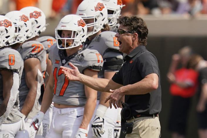 Oklahoma State head coach Mike Gundy gestures during a timeout in the second half of an NCAA college football game against Tulsa, Saturday, Sept. 11, 2021, in Stillwater, Okla. (AP Photo/Sue Ogrocki)