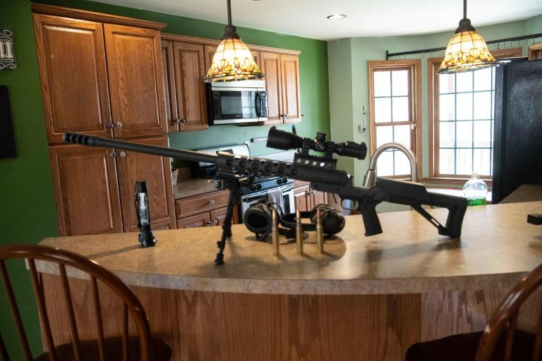 A 50-caliber gun sits on a counter top inside the Fortitude Ranch in Mathias, West Virginia, to show would-be new recruits just how seriously the members take this enterprise