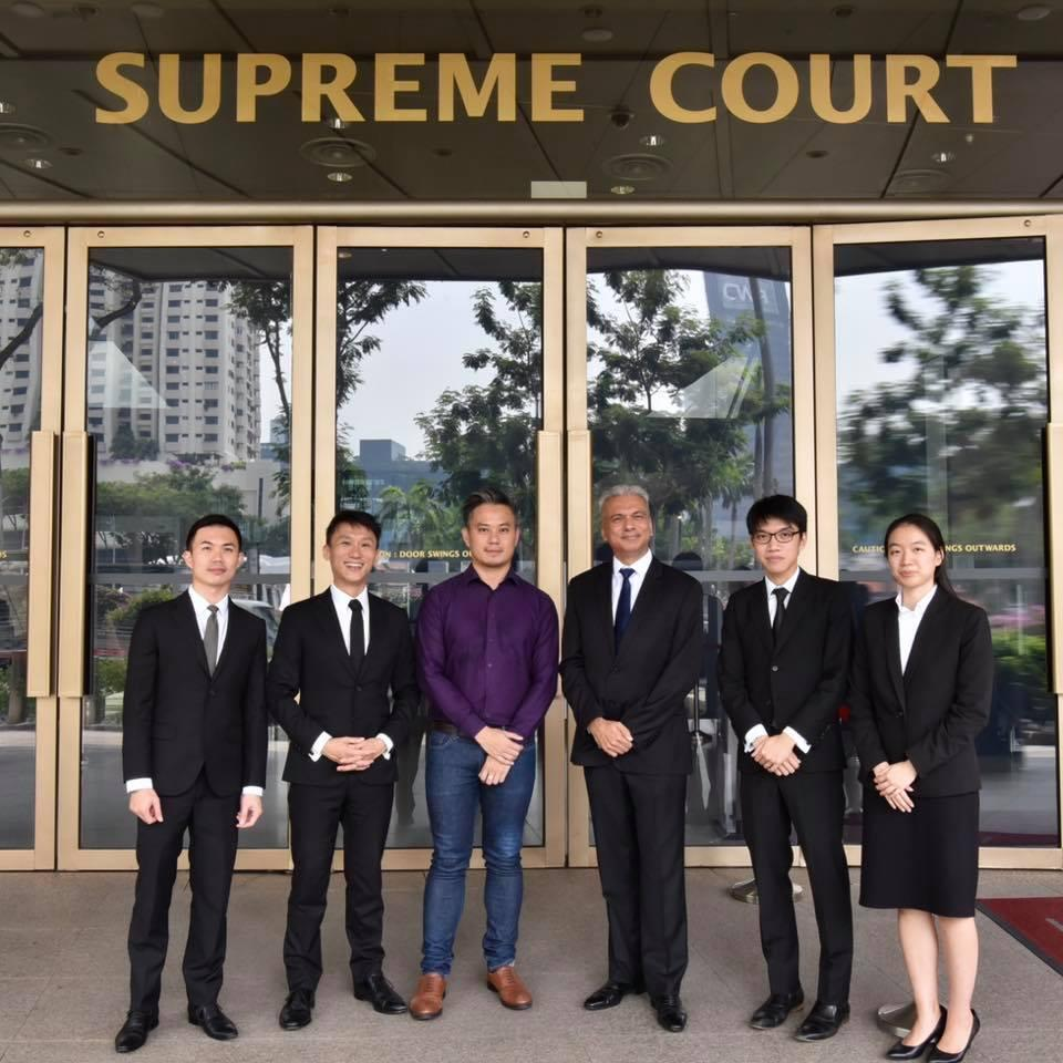 Bryan Choong Chee Hoong, a former executive director of non-profit LGBTQ social support group Oogachaga, with his lawyers.