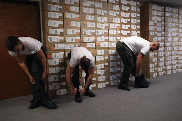 <p>New U.S. Border Patrol trainees try on boots while being fitted for uniforms at the U.S. Border Patrol Academy on August 3, 2017 in Artesia, N.M. (Photo: John Moore/Getty Images) </p>
