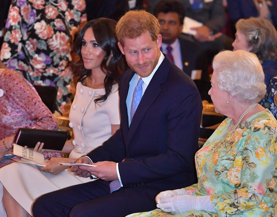 Britain's Queen Elizabeth II (R) talks with Britain's Prince Charles, Prince of Wales and Meghan,