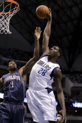 Dallas Mavericks center Ian Mahinmi (28), of France, goes up for a dunk over Charlotte Bobcats forward Derrick Brown (4) in the first half of an NBA basketball game Thursday, March 15, 2012, in Dallas. (AP Photo/Tony Gutierrez)