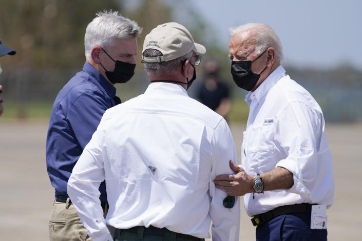 President Joe Biden talks with Louisiana Gov. John Bel Edwards and Sen. Bill Cassidy, R-La., left, as he arrives at Louis Armstrong New Orleans International Airport in Kenner, La., Friday, Sept. 3, 2021, to tour damage caused by Hurricane Ida. (AP Photo/Evan Vucci)
