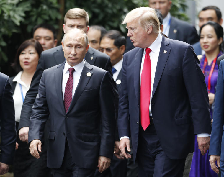 U.S. President Donald Trump, right, and Russia's President Vladimir Putin talk during the family photo session at the APEC Summit in Danang, Vietnam Saturday, Nov. 11, 2017. Trump and Putin may not be having a formal meeting while they're in Vietnam for an economic summit. But the two appear to be chumming it up nonetheless. Snippets of video from the Asia-Pacific Economic Cooperation conference Saturday have shown the leaders chatting and shaking hands at events including a world leaders' group photo. (Jorge Silva/Pool Photo via AP)