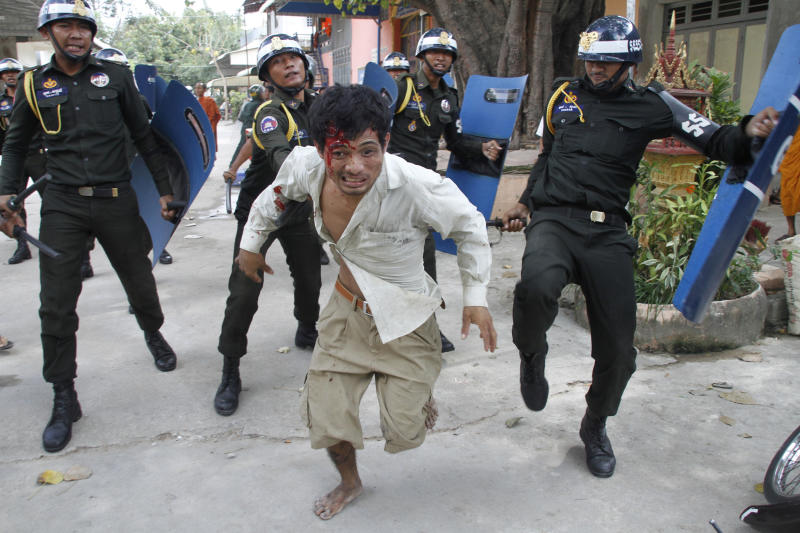 Cambodian police open fire on protesters; 1 dead