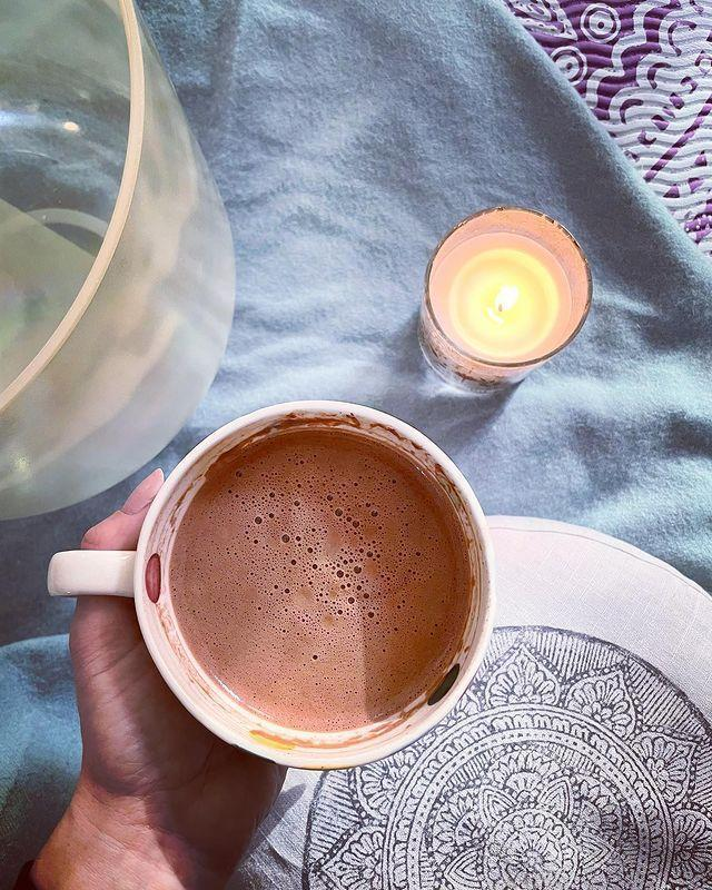 """<p>While Holly's weekdays require early mornings, she often shares her mindful weekend first thing rituals, such as enjoying a warming mug of cacao and lighting a candle, as she posted, here. Like you know, little acts of self-care can go a long way in helping you to feel calm, throughout your day. We know what we're doing, come Saturday. </p><p><a href=""""https://www.instagram.com/p/CNRtNMRh-Fc/"""" rel=""""nofollow noopener"""" target=""""_blank"""" data-ylk=""""slk:See the original post on Instagram"""" class=""""link rapid-noclick-resp"""">See the original post on Instagram</a></p>"""