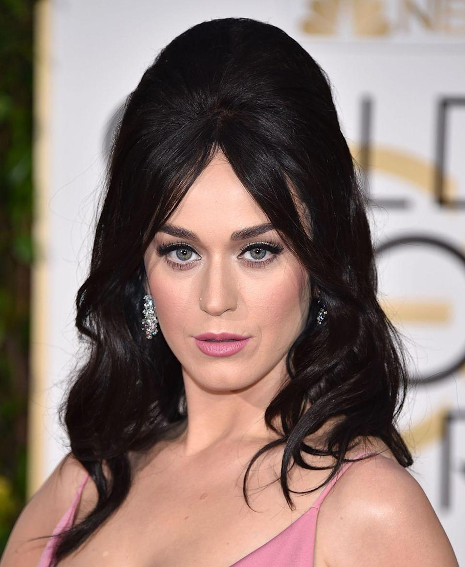 "<p>Singer Katy Perry is the queen of vintage-inspired hairstyles. To get her bouffant look, tease the upper back section of your hair and then pin it back with <a href=""https://www.amazon.com/Goody-Ouchless-Bobby-Brown-48/dp/B00E9SP888/ref=sr_1_5?tag=syn-yahoo-20&ascsubtag=%5Bartid%7C10055.g.33661606%5Bsrc%7Cyahoo-us"" rel=""nofollow noopener"" target=""_blank"" data-ylk=""slk:bobby pins"" class=""link rapid-noclick-resp"">bobby pins</a>. </p>"