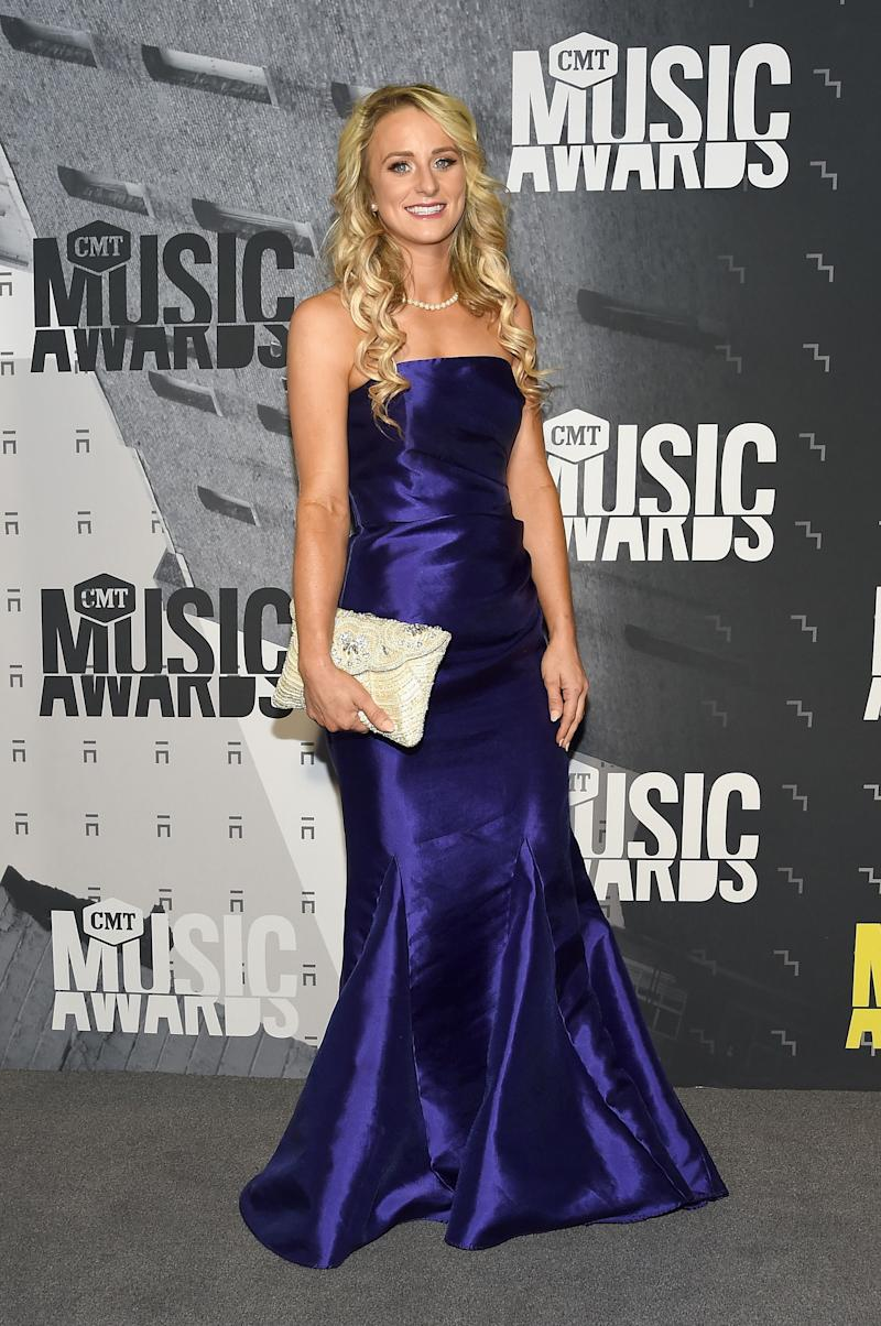 Leah Messer rocks in a floor-sweeping blue silk dress with a white purse to match