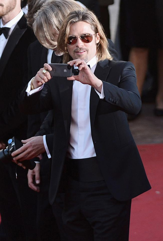 "<p class=""MsoNormal""><span style=""font-size:10.0pt;"">Sometimes, even celebrities want to capture the moment. A solo Brad Pitt busted out his iPhone to snap a couple of pics on the red carpet a<span style=""color:black;"">t the premiere of his upcoming movie ""Killing Them Softly"" in Cannes on Tuesday. Wonder if he emailed it to Angelina and the kids … </span></span></p>"