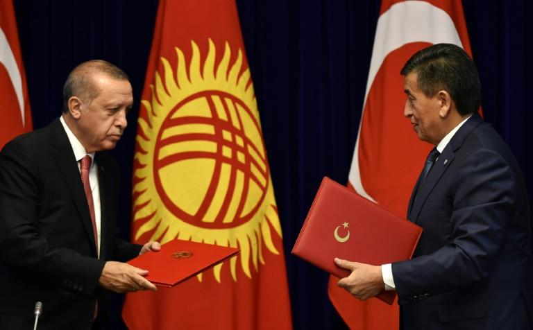 "Turkish President Recep Tayyip Erdogan, seen meeting Kyrgyz counterpart Sooronbay Jeenbekov, said he would not want his hosts ""to have the same problems we faced,"" referring to the 2016 failed coup Ankara  blames on Gulen backers"