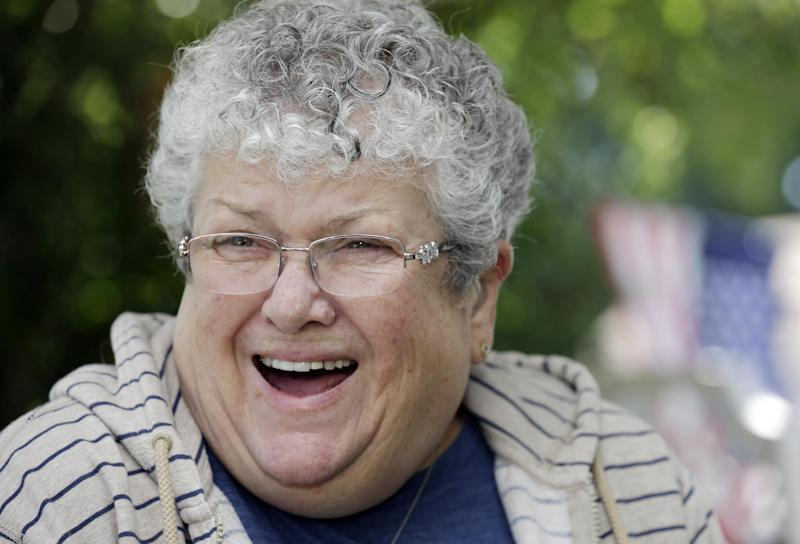 Former school bus monitor Karen Klein talks with a reporter at her home in Greece, N.Y., Wednesday, June 19, 2013. Now retired, Klein says she used $100,000 to seed the Karen Klein Anti-Bullying Foundation to promote kindness. (AP Photo/David Duprey)