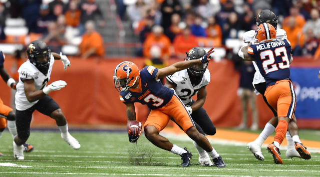 Syracuse defensive back Christopher Fredrick (3) returns an interception before tackled by Wake Forest running back Kenneth Walker III during the first half of an NCAA college football game in Syracuse, N.Y., Saturday, Nov. 30, 2019. (AP Photo/Adrian Kraus)