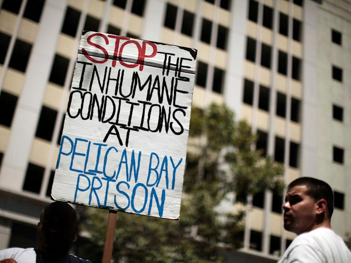 Jose Flores, 27, (L) and Eddie Ramirez, 24, attend a rally in Los Angeles, California August 1, 2011, in support of California inmates who spent weeks on a hunger strike to protest prison conditions. The U.S. has 5 percent of the world's population, 25 percent of the world's prisoners and an incarceration rate five times as high as the rest of the world.