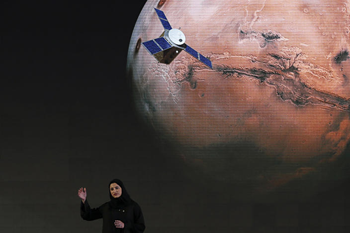 """FILE - In this Wednesday, May 6, 2015 file photo, Sarah Amiri, deputy project manager of the United Arab Emirates Mars mission, talks about the project named """"Hope,"""" or """"al-Amal"""" in Arabic, which is scheduled for launch in 2020, during a ceremony in Dubai, UAE. Three countries — the United States, China and the United Arab Emirates — are sending unmanned spacecraft to the red planet in quick succession beginning in July 2020. (AP Photo/Kamran Jebreili, File)"""