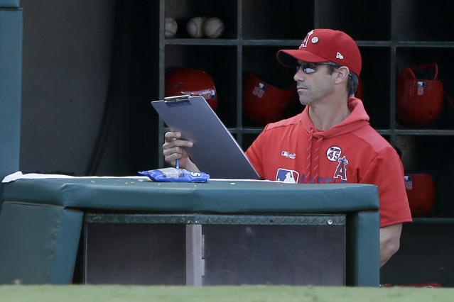 Los Angeles Angels manager Brad Ausmus picks up his clipboard after the last out in the ninth inning as the Houston Astros defeat his team in a baseball game in Anaheim, Calif., Sunday, Sept. 29, 2019. (AP Photo/Alex Gallardo)