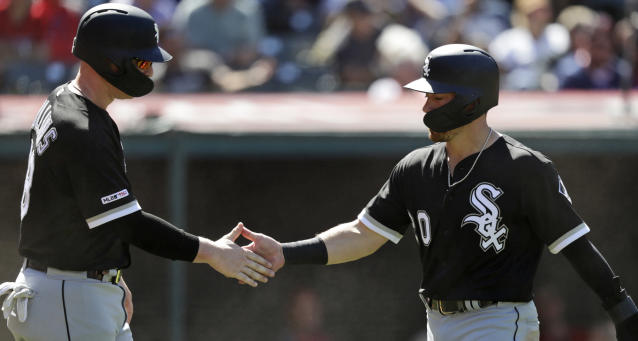 Chicago White Sox's Zack Collins, left, and Danny Mendick celebrate after both score on Adam Engel's two-run single in the sixth inning in a baseball game against the Cleveland Indians, Thursday, Sept. 5, 2019, in Cleveland. (AP Photo/Tony Dejak)