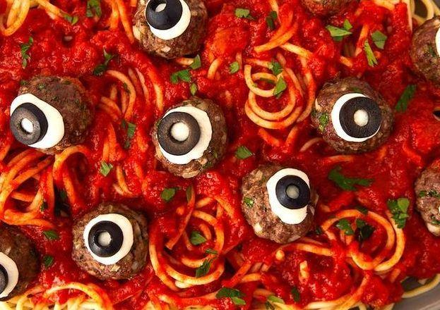 """<p>Dinner on Halloween can be anything but regular—it's gotta be spooky! We're obsessed with turning ordinary meatballs into scary works of art by making them look like monster eyeballs. All you need is some mozzarella (fresh works best since it's thicker) and black olives. </p><p>Get the <a href=""""https://www.delish.com/uk/cooking/recipes/a29221858/eyeball-pasta-halloween-dinner-recipe/"""" target=""""_blank"""">Eyeball Pasta</a> recipe.</p>"""