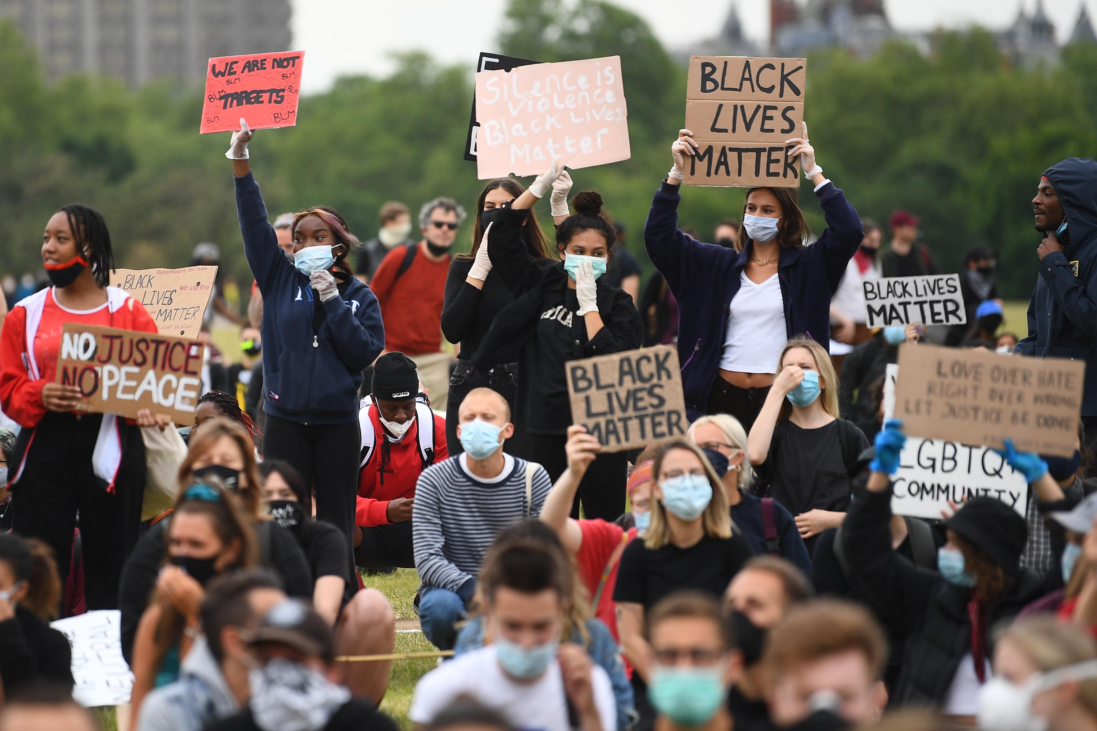 People participate in a Black Lives Matter protest rally in Hyde Park, London, in memory of George Floyd who was killed on May 25 while in police custody in the US city of Minneapolis.