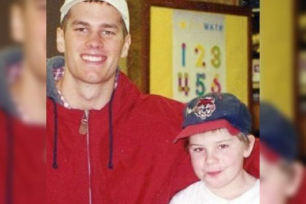 While in college at Michigan, Tom Brady tutored Charles Fahlsing, a third-grader who went on to attend Michigan himself. (Courtesy of Charles Fahlsing)