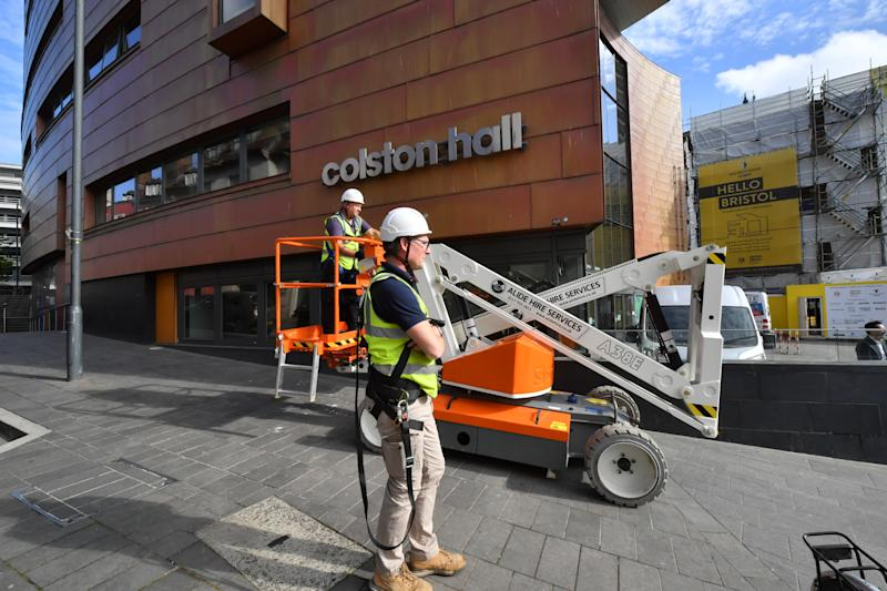"Contractors outside Bristol music venue Colston Hall for the removal of the name of 17th century merchant Edward Colston from its signage after a row over his involvement in the slave trade. The venue said the move was ""just one step on our road to announcing a new name for the venue in autumn 2020""."