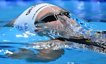 <p>Israel's Anastasya Gorbenko competes in the final of the women's 100m backstroke swimming event during the Tokyo 2020 Olympic Games at the Tokyo Aquatics Centre in Tokyo on July 27, 2021. (Photo by Oli SCARFF / AFP)</p>