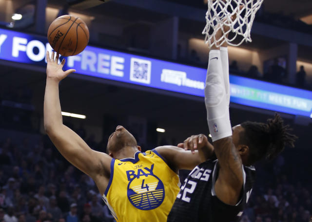 Golden State Warriors forward Omari Spellman, left, is fouled by Sacramento Kings forward Richaun Holmes, right, during the first quarter of an NBA basketball game in Sacramento, Calif., Monday, Jan. 6, 2020. (AP Photo/Rich Pedroncelli)