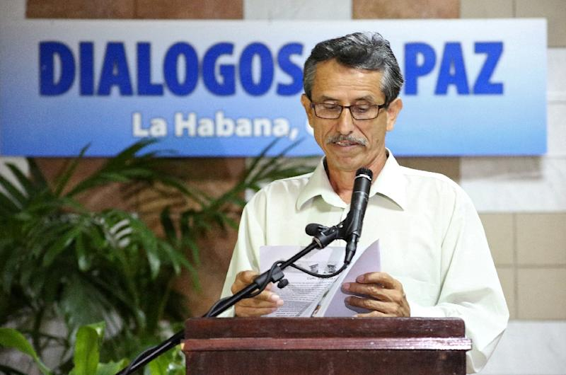 Picture released by the FARC-EP delegation shows FARC commander Walter Mendoza reading a statement during peace talks with the Colombian government in Havana, Cuba, on June 3, 2015