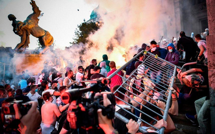 Protesters clash with police outside the Serbian National Assembly in Belgrade