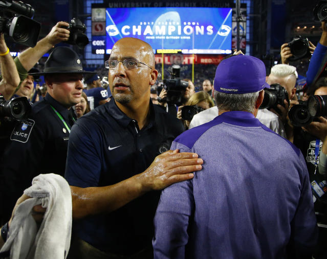 FILE - In this Dec. 30, 2017, file photo, Penn State head coach James Franklin, front left, greets Washington head coach Chris Petersen, right, after the Fiesta Bowl NCAA college football game, in Glendale, Ariz. College football as a public entity cant institute a Rooney Rule like the NFL to compel programs to interview minority candidates for head coaching jobs. Minorities make up only 19 percent of Division I head football coaches and less across the Power Five conferences: the ACC, SEC, Big Ten, Big 12 and Pac 12. (AP Photo/Ross D. Franklin, File)