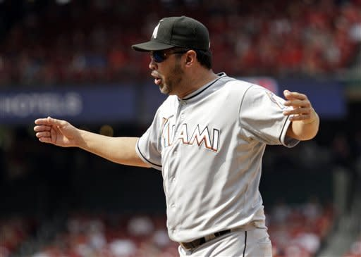 Miami Marlins manager Ozzie Guillen argues a play at first in the ninth inning of a baseball game against the St. Louis Cardinals, Sunday, July 8, 2012, in St. Louis. The Cardinals won 5-4.(AP Photo/Tom Gannam)