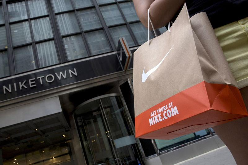 File photo of a customer exiting the Niketown store in midtown Manhattan in New York