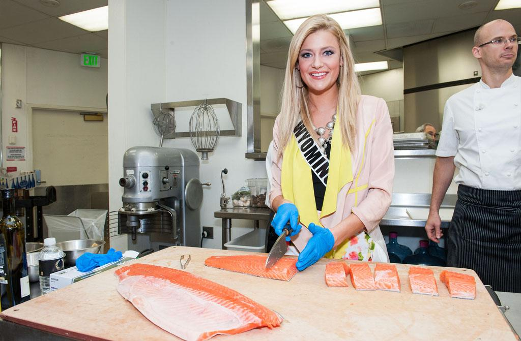Miss Wyoming USA 2013, Courtney Gifford cuts a piece of salmon during the Cooking Demo and Lunch event at Gordon Ramsay Pub & Grill at the Caesars Palce, in Las Vegas, Nevada on Tuesday, June 4, 2013.