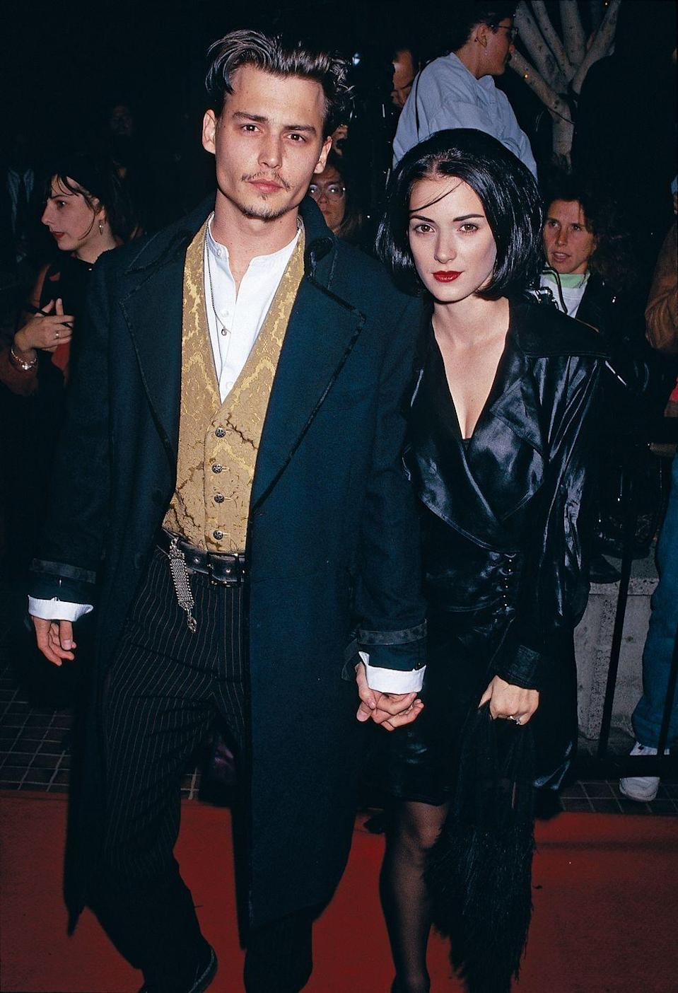 """<p>""""There's been nothing in my 27 years that's comparable to the feeling I have with Winona,"""" Depp <a href=""""http://people.com/celebrity/johnny-depp-and-winona-ryder-their-romance-and-relationship/"""" rel=""""nofollow noopener"""" target=""""_blank"""" data-ylk=""""slk:told"""" class=""""link rapid-noclick-resp"""">told </a><em><a href=""""http://people.com/celebrity/johnny-depp-and-winona-ryder-their-romance-and-relationship/"""" rel=""""nofollow noopener"""" target=""""_blank"""" data-ylk=""""slk:People"""" class=""""link rapid-noclick-resp"""">People</a></em> after meeting Ryder at a film premiere in 1990. The couple would go on to co-star in <em>Edward Scissorhands </em><span class=""""redactor-invisible-space"""">together and</span> <a href=""""http://people.com/archive/the-insider-vol-39-no-24/"""" rel=""""nofollow noopener"""" target=""""_blank"""" data-ylk=""""slk:got engaged five months later"""" class=""""link rapid-noclick-resp"""">got engaged five months later</a> but eventually split in June 1993. As a declaration of his love for the actress, Depp famously got a """"Winona Forever"""" tattoo (which he later changed to """"Wino Forever"""") </p>"""