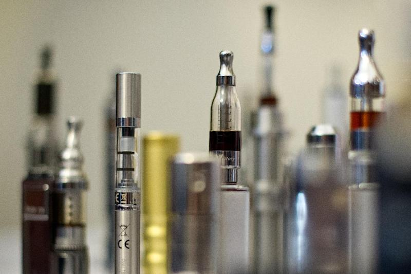"""A selection of """"Nicotine Containing Products"""" are displayed during """"The E-Cigarette Summit"""" at the Royal Academy in central London on November 12, 2013 (AFP Photo/Leon Neal)"""