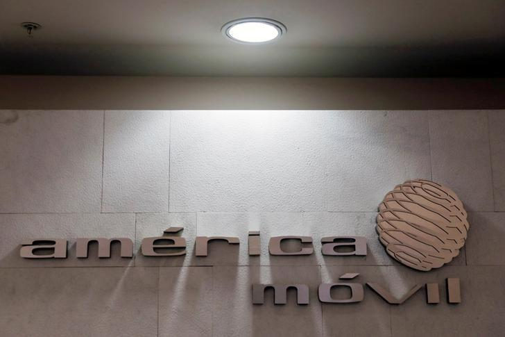 FILE PHOTO: The logo of America Movill is seen on a wall at the company's corporate offices in Mexico City