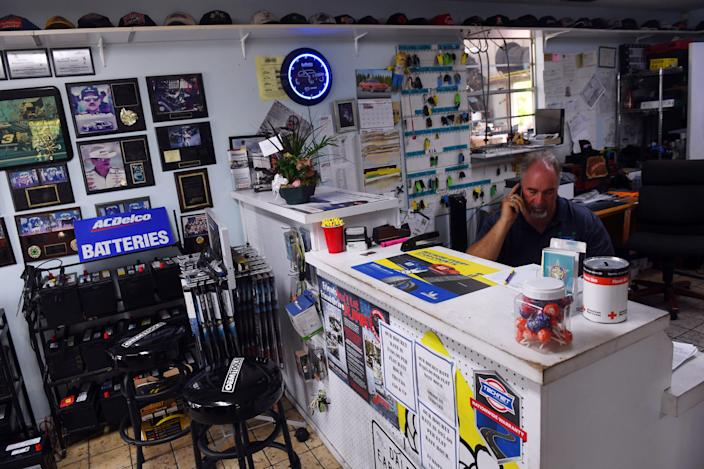 """""""Now I have to pick up most of the office work that my brother used to do,"""" said Bobby Ford as he makes phone calls on Wednesday, Sept. 1, 2021 at Bobby's Auto Service Center in Vero Beach. Ford's twin brother, Billy, did most of the office work, but was infected with COVID-19 and died Aug. 14, Bobby Ford said. Billy Ford was unvaccinated."""