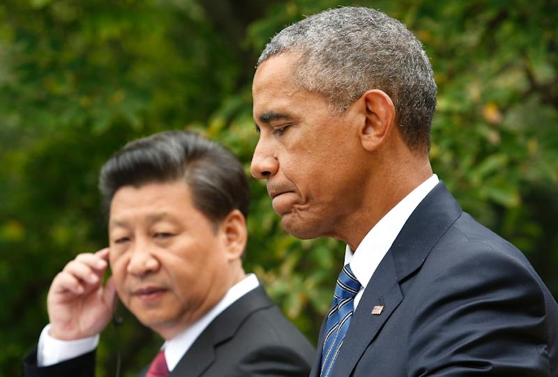 US President Barack Obama speaks next to Chinese President Xi Jinping during a joint press conference after their meeting at the White House, in Washington, DC, in September 2015 (AFP Photo/Yuri Gripas)