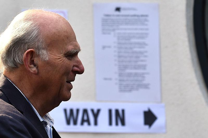 Lib Dem leader Vince Cable arrives at a polling station in his Twickenham constituency on Thursday (Glyn Kirk/AFP/Getty Images)