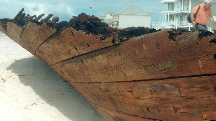 The wreckage of the schooner Rachel sits on Fort Morgan beach in Gulf Shores, Ala., on Thursday, Sept. 6, 2012. The Rachel ran aground during a storm on Oct. 17, 1923. She has been uncovered and re-covered by storms and hurricanes many times since, and was uncovered again during Hurricane Isaac. (AP Photo/Melissa Nelson Gabriel)