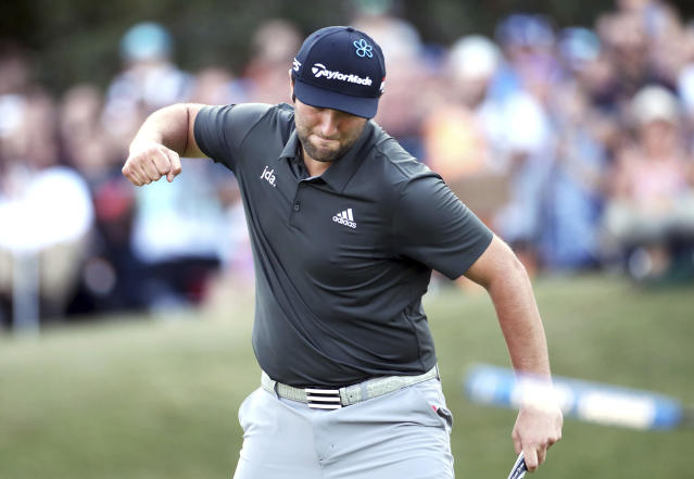 Spain's Jon Rahm celebrates on the 18th hole during day three of the BMW PGA Championship at Wentworth Golf Club, Wentworth, England, Saturday Sept. 21, 2019. (Bradley Collyer/PA via AP)