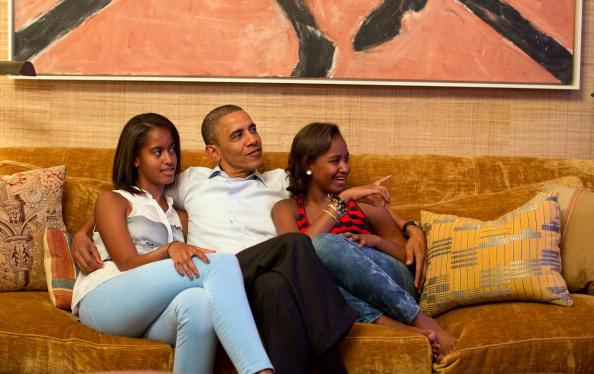 In this handout photo provided by The White House, U.S. President Barack Obama and his daughters, Malia (L) and Sasha, watch on television as first lady Michelle Obama takes the stage to deliver her speech at the Democratic National Convention on September 4, 2012 in the Treaty Room of the White House in Washington, DC. The DNC that will run through September 7, will nominate U.S. President Barack Obama as the Democratic presidential candidate. (Photo by Pete Souza/White House Photo via Getty Images)