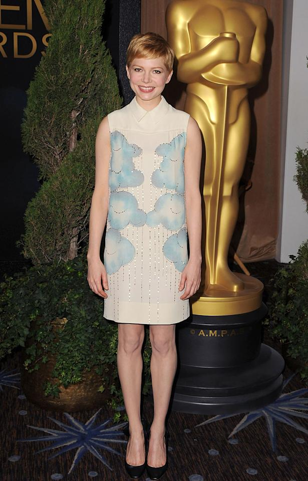 """My Week with Marilyn"" star Michelle Williams donned a dainty Victoria Beckham-designed dress and boring black pumps."