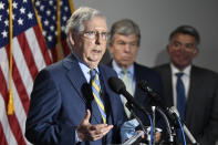 Senate Majority Leader Mitch McConnell of Ky., left, speaks to reporters following the weekly Republican policy luncheon on Capitol Hill in Washington, Tuesday, June 9, 2020. Sen. Roy Blunt, R-Mo., center, and Sen. Cory Gardner, R-Colo., right, listen. (AP Photo/Susan Walsh)
